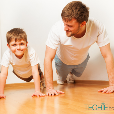 A dad and son working out with the Wii fit.
